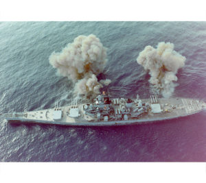 "The 16"" guns firing broadside"