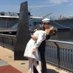"""A  life-size bronze sculpture of the famous Times Square """"kiss"""" by American artist  Seward Johnson, will be on display on the Pier of the Battleship New Jersey through the summer.  Embracing Peace by Seward Johnson © 2004 The Seward Johnson Atelier, Inc. www.sewardjohnsonatelier.org"""