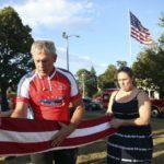 Col West folding a flag