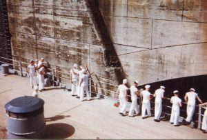 BB-62 sailors touching the walls of the Panama Canal as she passes through